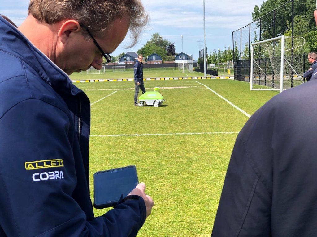 Arjen Spek with the Intelligent One robot to line mark sports fields